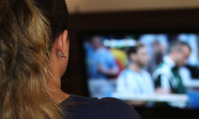 Woman watching sport on tv